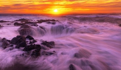 Famous Thor's Well at Sunset.