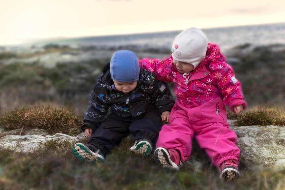 After walking in the difficult terrain the twins take a break, and the girl is as always attentiv...