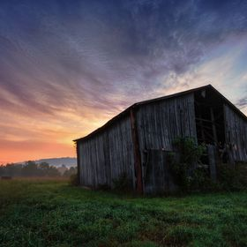 The old and forgotten barns in outskirts of the Great Smoky Mountains make for a picturesque sunrise subject.