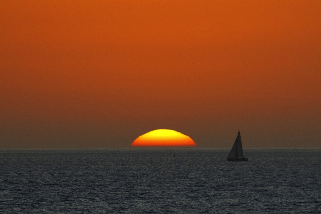 """During a recent vacation to Langebaan, South Africa, this opportunity presented itself. Due to the fast """"sinking"""" sun and slow moving sail boat this in my opinion is the best of aproximately 30 shots."""