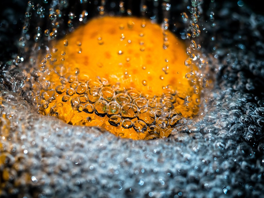 Water droplets on an orange.