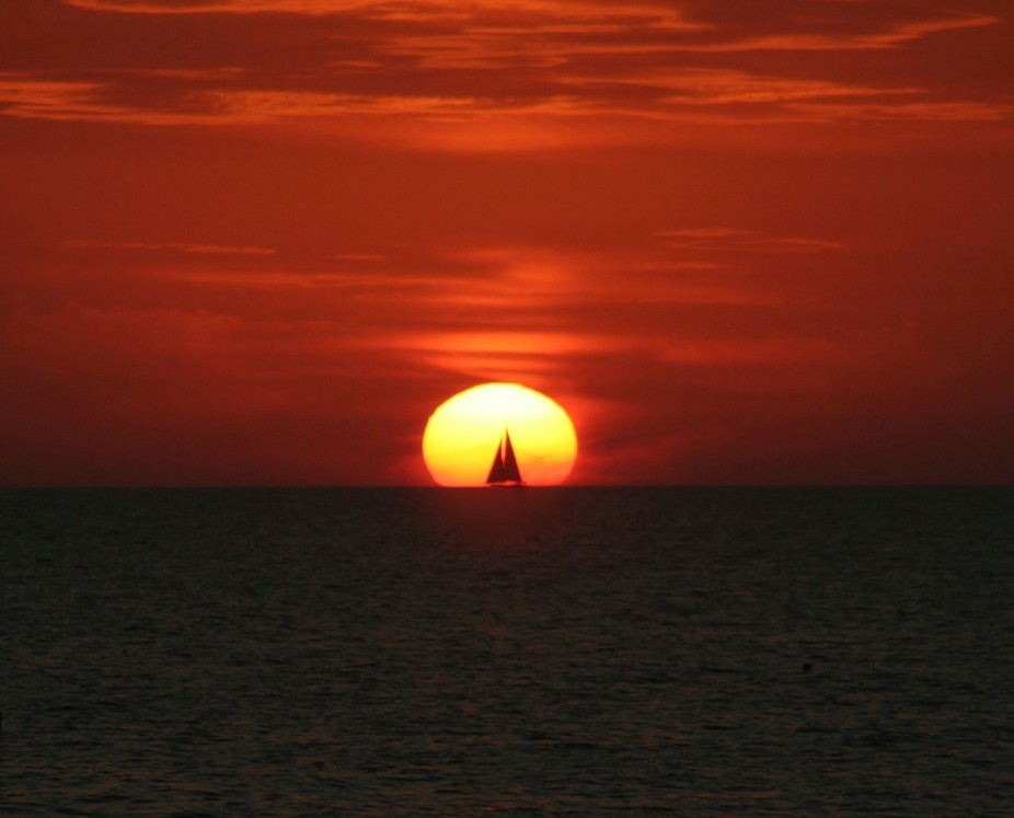 Madeira Bch., Fl and I saw this sailboat coming down from Clearwater Bch and the timing of the sh...