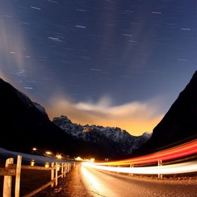 Shot was taken in valley Logarska in Slovenia. Those car light in foreground was me driving by.