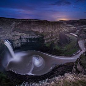 Palouse Falls empties into a 300 foot basin.  At night it is a black hole.  This is two shots. Below the horizon was a 4 minute exposure and the ...
