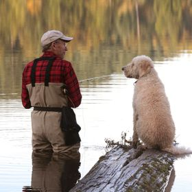 Back in 2008 Monty was a 3 year old Labradoodle who loves the water and going fishing. In this shot he and Mike shared a spontaneous moment, perh...