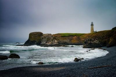 Yaquina Head lighthouse from Cobble Beach