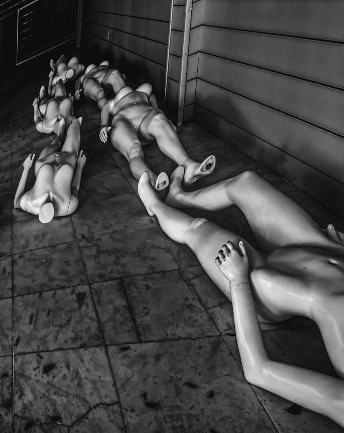 Was walking down Duval Street in Key West, Florida.  I noticed these mannequins through a window in a closing store.