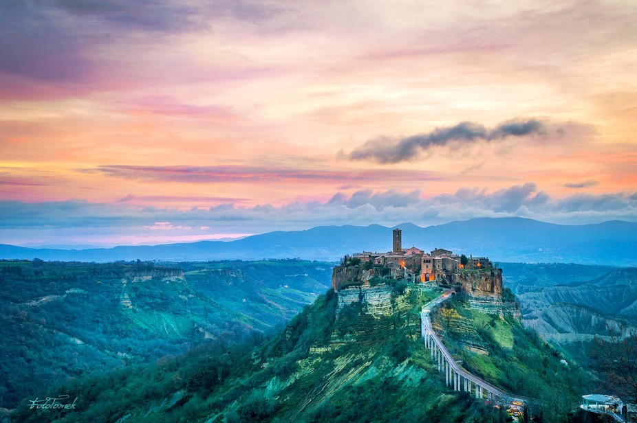 Cloudy dawn over Civita di Bagnoregio, Lazio (Italy).