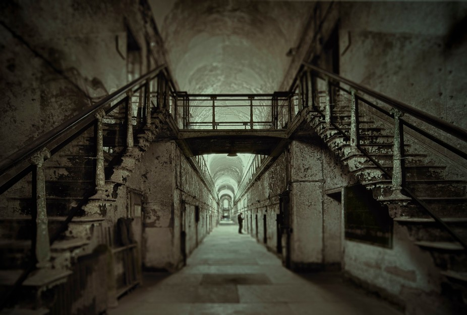 Eastern State Penitentiary was once the most famous and expensive prison in the world, but stands today in ruin, a haunting world of crumbling cellblocks and empty guard towers.  I chose to add the look of 'Walking Dead' prison to the photo.