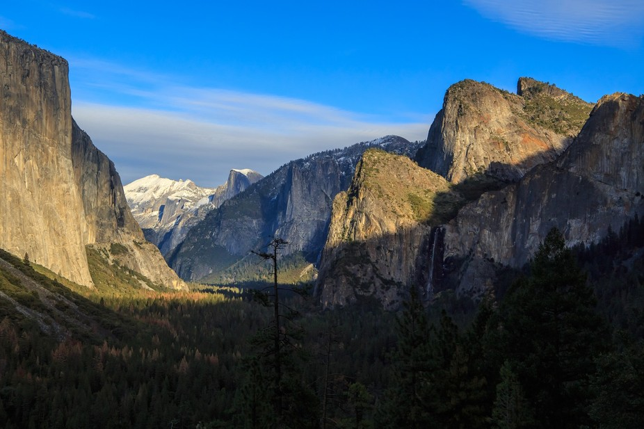 Afternoon shadows begin to darken the valley in Yosemite National Park, California. Many of the t...