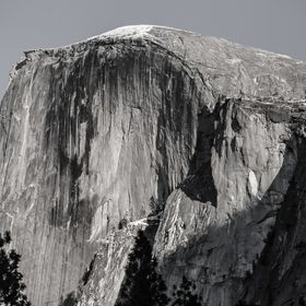 November afternoon sunlight illuminates Half Dome in Yosemite National Park, California. Color original is converted to black and white with touc...