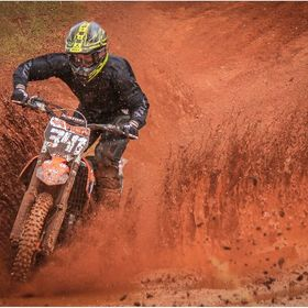 Motocross rider on a wet track.