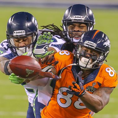 Feb 2, 2014; East Rutherford, NJ, USA; Seattle Seahawks cornerback Richard Sherman (25) makes a play on the ball against Denver Broncos wide receiver Demaryius Thomas (88) during the fourth quarter in Super Bowl XLVIII at MetLife Stadium.