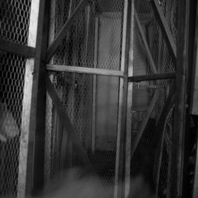 creepy, dark, musty, old, bad feeling backroom in an old laundry facility at an apartment complex in Memphis. my toddler ran into the shot as i w...