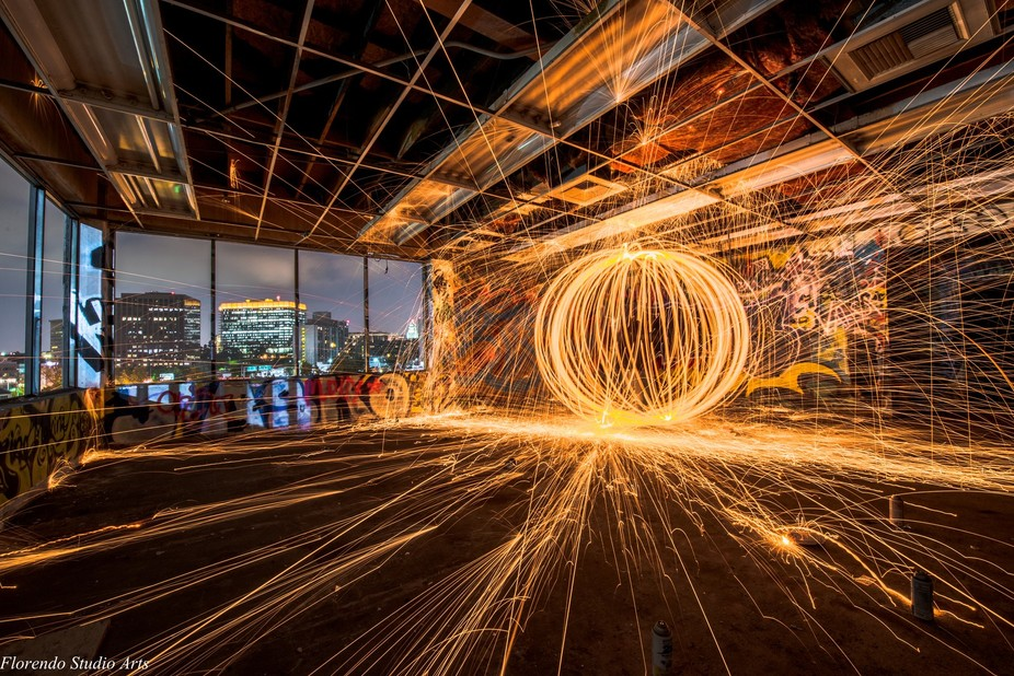 Burned down building in Los Angeles and steel wool spinning-