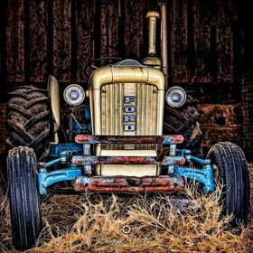 An old tractor in a barn just begging me to bring it back to life.  I did my best...