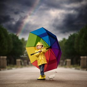 What is there to do on a rainy day but grab some snaps with a colorful umbrella in the street!  You can see more of my work at www.abbymathisonph...