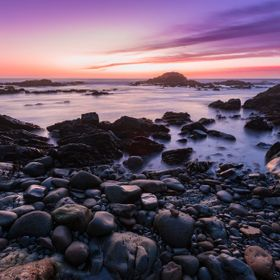 An amazing sunset near Bean Hollow State Beach in California. A recent storm cleared just in time to reveal an epic purple, pink, and orange sunset.