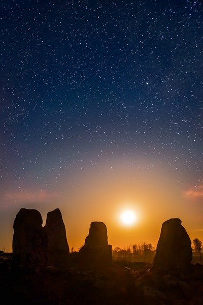 Full Moon rising above ancient stone circle