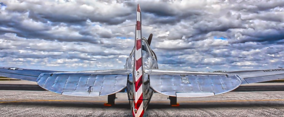 An vintage WWII airplane waiting on the tarmac at the Punta Gorda Florida Airport.