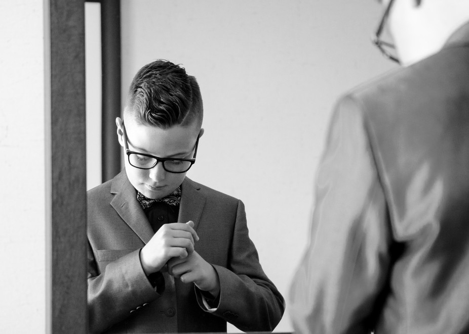 This guy was quit shy when we first met at his aunts wedding. While the main Photographer Kelly C...