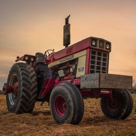 An old International tractor sits in a field in NY