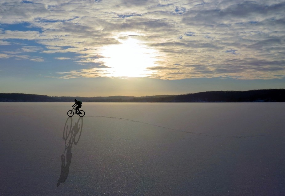 This biker frequently rode across the frozen lake during the winter.