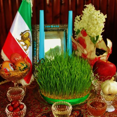 20-21 March, Iranian New Year (Nowrooz)                                                               Haft Sīn (Persian:, the seven seen's) is a tabletop arrangement of seven symbolic items traditionally displayed at Nowruz, the Persian new year. The haft-seen table includes seven items all starting with the letter S ( seen)  in the Persian alphabet. The Haft-Seen items are:     Sabzeh  – wheat,  mung bean or lentil  growing in a dish - symbolizing rebirth     Samanu  – sweet pudding made from wheat germ – symbolizing affluence     Senjed  – dried oleaster mountain ash fruit – symbolizing love     Seer  – garlic – symbolizing the medicine and health     Seeb  – apple – symbolizing beauty     Somāq  – sumac fruit – symbolizing (the color of) sunrise     Serkeh – vinegar – symbolizing old-age and patience Also some other thing are included and have meaning as well, like: Candel & Mirror - lights and expressiveness Egg- life Hyaicinth - spring