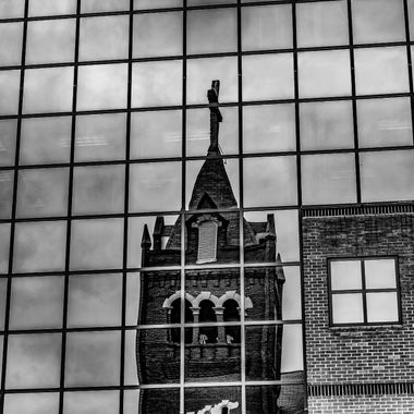 """Bethel AME Church, Columbia, SC reflected in the window of the Baptist Hospital's office building/garage on Taylor Street in Columbia, SC.  This photo is from a series I shot for a contest at a local café here in Columbia, SC.  The café, Michael's Café & Catering, hosted a showing of 11 photographs taken by me and used in a """"visual scavenger hunt"""" of the city.  This particular photo was used in the contest."""