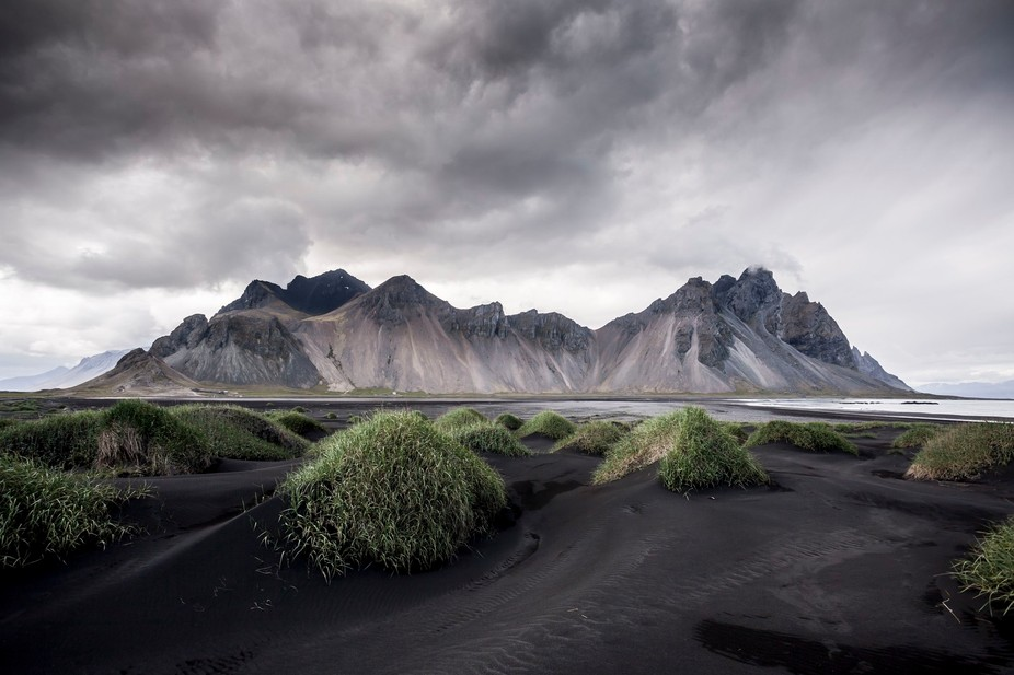 Beautiful black sand in front of impressive mountains.