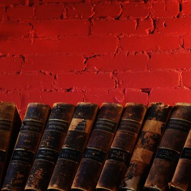 red wall with old books