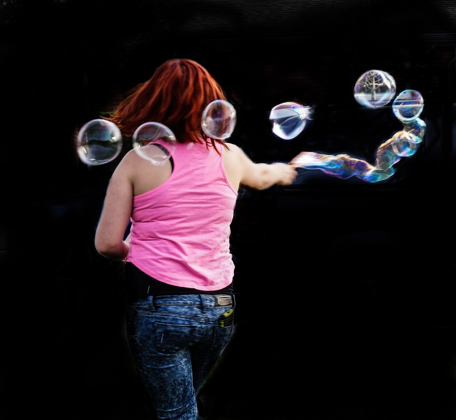 My granddaughter was twirling with a large bubble wand and I was lucky to catch a photo of it.