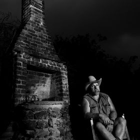 The King Island Cowboy sitting at the site of the original Dinibili Homestead kitchen Chimney.