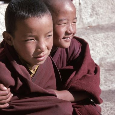 These two young boys were among a group of young monks sitting on the front steps of a Buddhist temple in Tibet