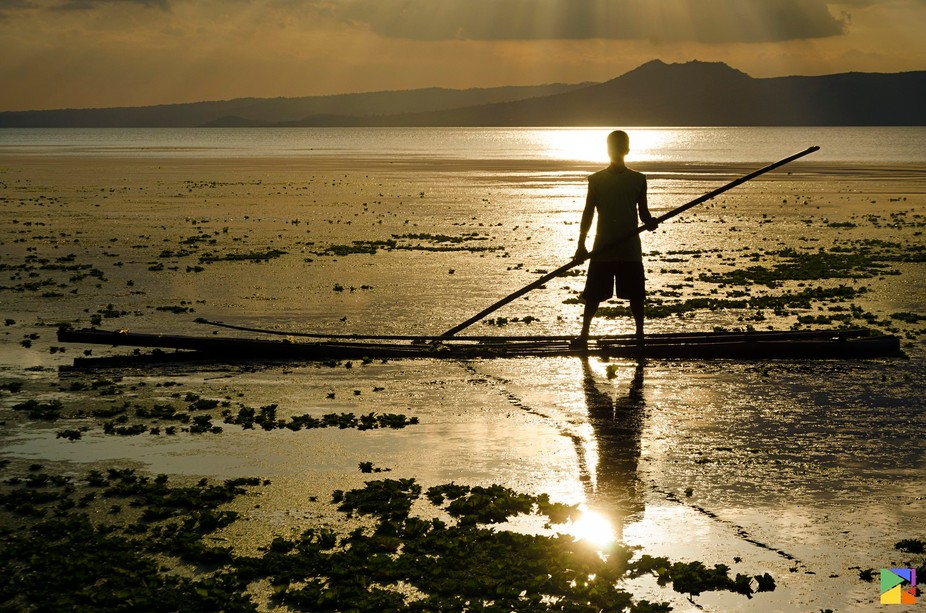 Boatman sailing through beautiful sunset of Taal Lake :)