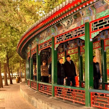The great long corridor connecting the Summer Palace to the lake, sheltering the Empress on the long walk.  Hand painted with different motifs at every post.  Just magnificent to behold.  Beijing.