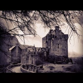 A dark perspective of the amazing and mystic Eilean Donan Castle at the Scottish highlands.