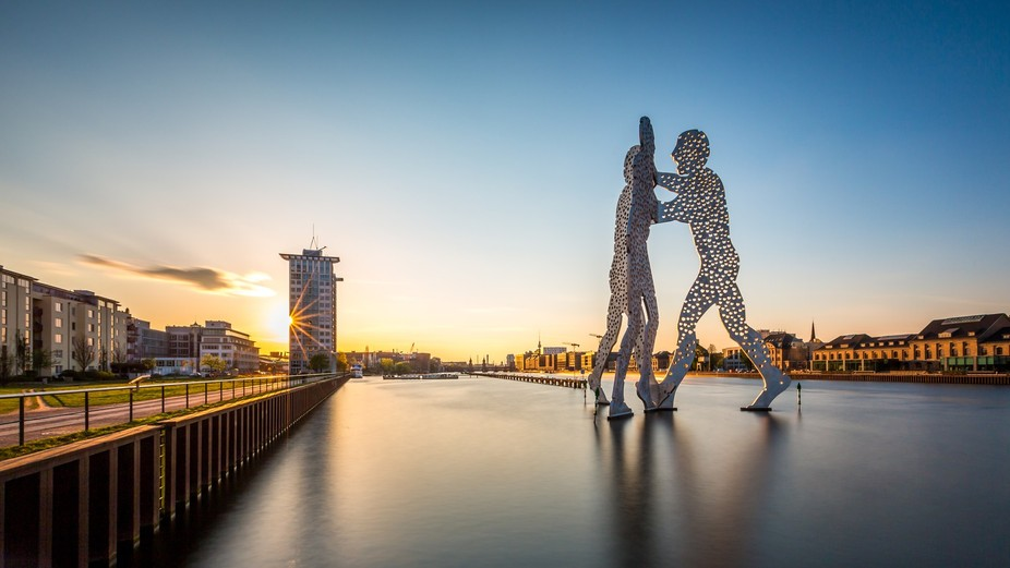 The Molcecule Man sculpture on the river Spree in Berlin. This is actually the spot where three d...