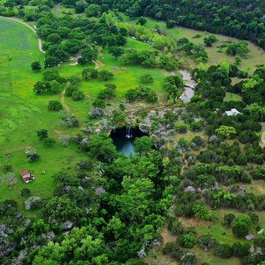 The Limestone formations of the Texas Hill Country are dotted with swimming holes and cave grottos.  Image shot from helicopter.