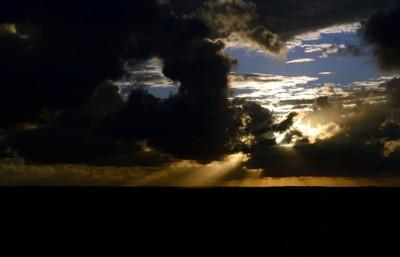Drammatic Sunrise Amidst Dark Clouds