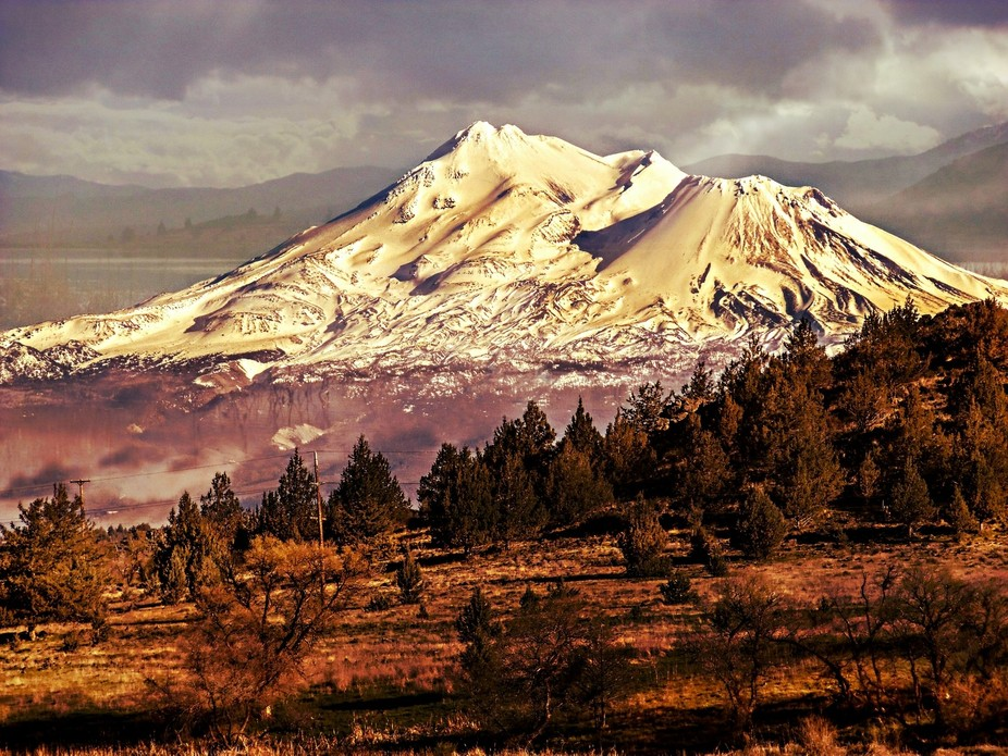 Mt.Shasta  and some of the landscape  of the Shasta valley at sunset