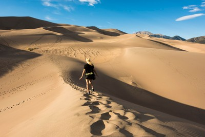 My wife traversing the Great Sand Dunes in Colorado