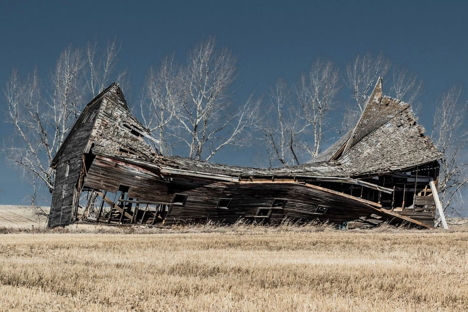 Historic Hip Roof Barn on deserted homestead falling to ruin
