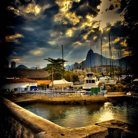 The magical quarter of Urca, Rio de Janeiro, portrayed at the end of a beautiful afternoon, in spite of the overcast sky. Near the Marina, where ...