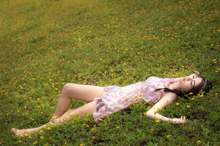 A beauty girl sleeping in the flower field.