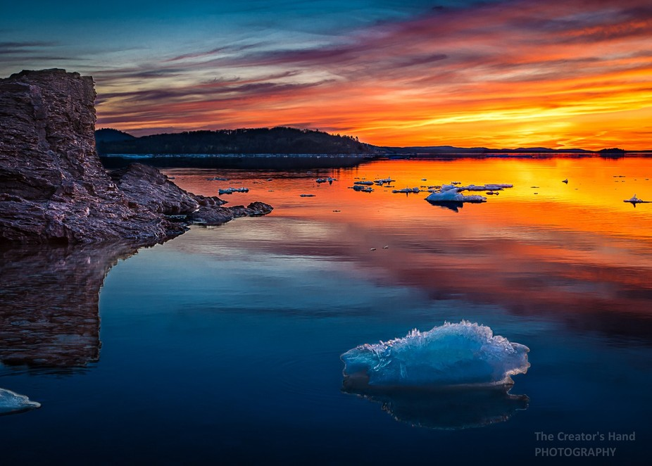 Ice floes on Lake Superior at sunset at Presque Isle Park in Marquette, Michigan.
