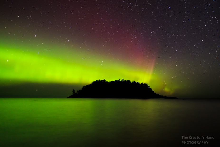 Northern Lights over Little Presque Isle on Lake Superior North of Marquette, Michigan