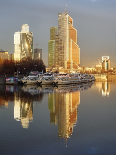 Golden hour in the capital of Russia. Boat on the Moscow-River and Moscow-City