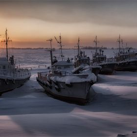 Ships in the winter in the snow waiting for spring