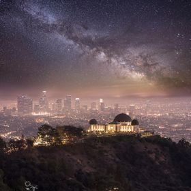 A composite image of Griffith Observatory shot from Mount Hollywood combined with a Milky Way pic taken up in Door County, WI.  This is what LA w...